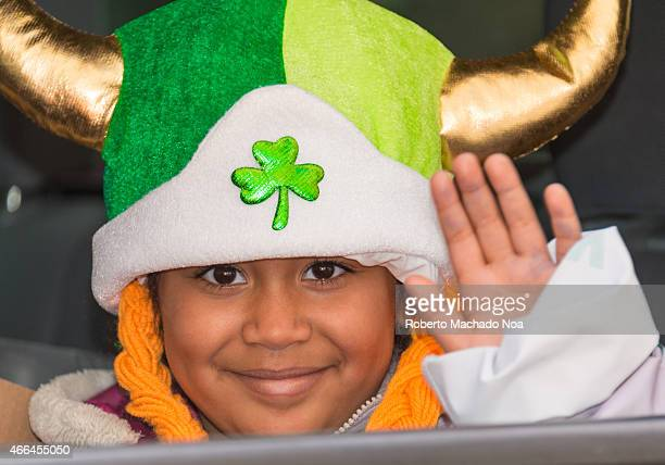 STREET TORONTO ONTARIO CANADA Child wearing a leprechaun hat during the St Patrick's Day Parade 28th edition which is the fourth largest celebration...