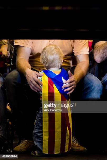 A child wearing a proindependence flag is seen during a 'Junts pel Si' coalition rally on September 24 2015 in Girona Spain The main Catalanist...