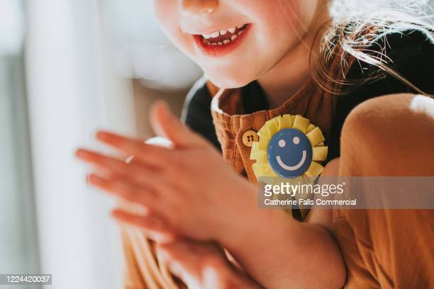 child wearing a rosette - second place stock pictures, royalty-free photos & images