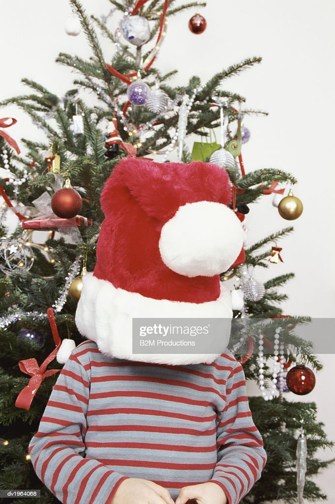 Child Wearing an Oversized Santa Hat : Stock Photo