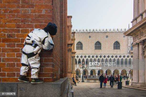A child wearing carnival costume pose in St Mark square during the 2018 Venice Carnival on January 28 2018 in Venice Italy The theme for the 2018...