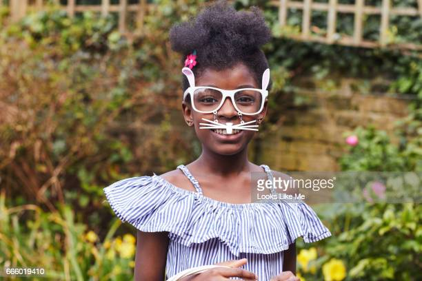 Child wearing Easter Bunny glasses.