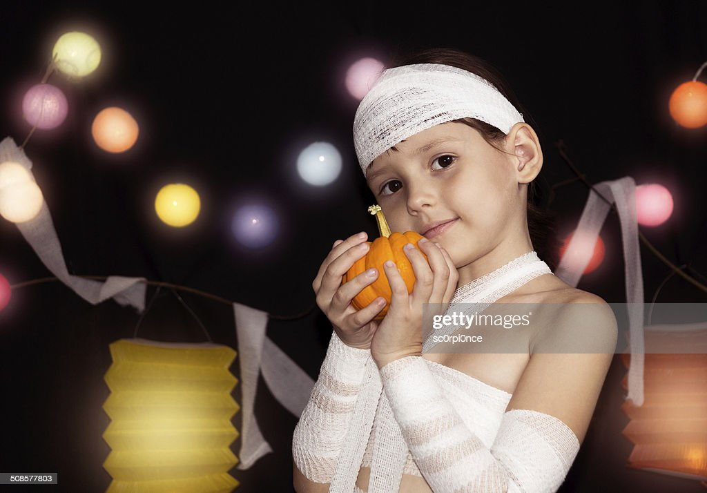 child wearing mummy costume : Stock Photo