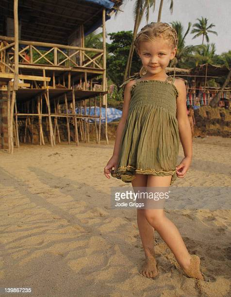 Child wearing new top at beach market in India