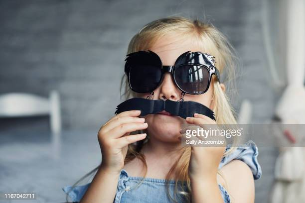 child wearing novelty sunglasses - novelty item stock pictures, royalty-free photos & images