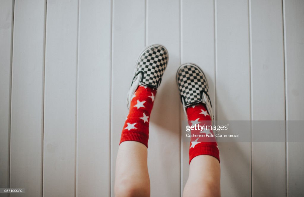 Child wearing shoes : Stock Photo