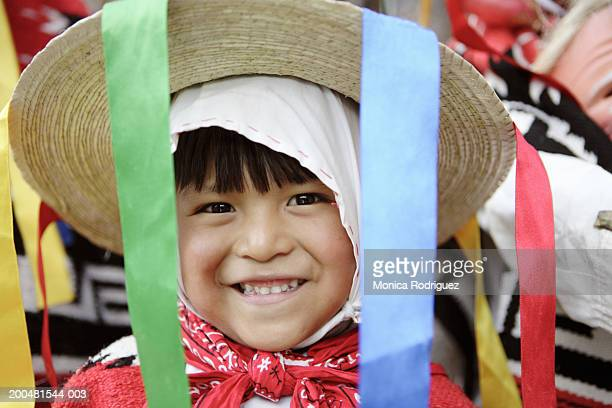 Child wearing traditional costume and hat