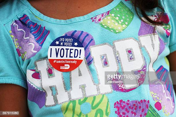 A child wears a 'I Voted' sticker after her mother voted in the Florida primary on August 30 2016 in Miami Florida There are Senate seats as well as...