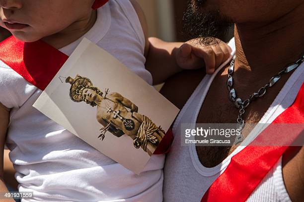 Child wears a red stripe with an image of San Sebastiano attached to it, during the Christian Catholic festival commemorating San Sebastiano, Patron...