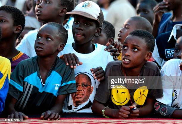 A child wears a tshirt with an image of Senegalese President Macky Sall during a rally at Pikine near Saint Louis on February 19 ahead of scheduled...