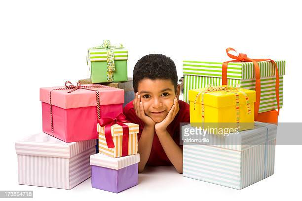 Child whit a stack of gifts