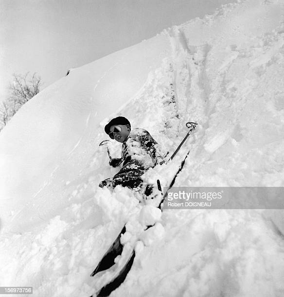 Child who just fell in the powder snow, 1936 in Megeve, France.