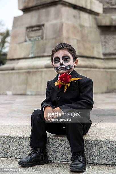 A child who wears a skeleton makeup poses during the 'Catrinas Parade' a joyful annual event celebrated at the Day of the Dead on October 23 2016 in...