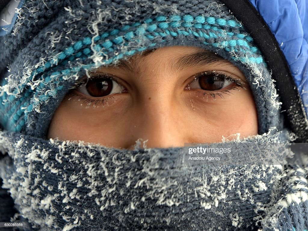 A child, whose eyelash frozen due to the cold weather while