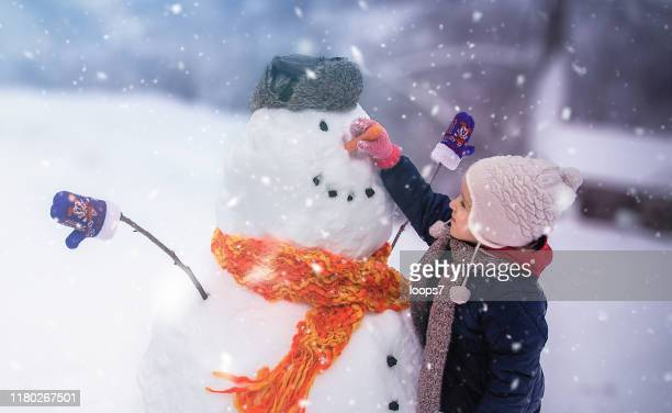child winter outdoor fun - winter stock pictures, royalty-free photos & images