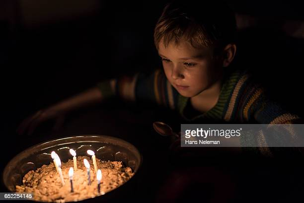 Child with a birthday cake
