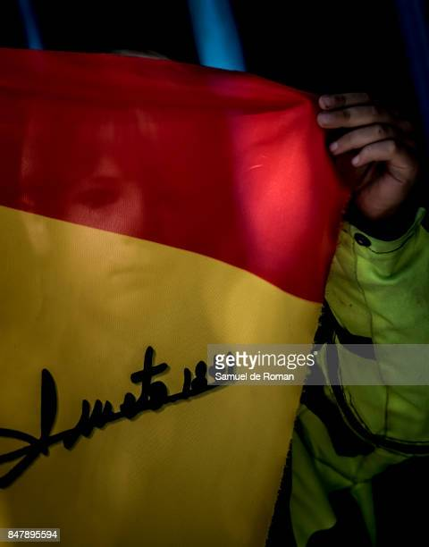 A child with a flag of Angel Nieto during the Funeral Tribute For Angel Nieto in Madrid on September 16 2017 in Madrid Spain