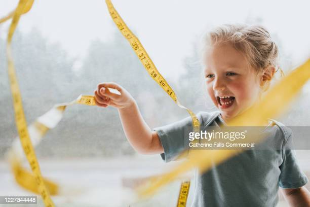 child with a measuring tape - instrument of measurement stock pictures, royalty-free photos & images