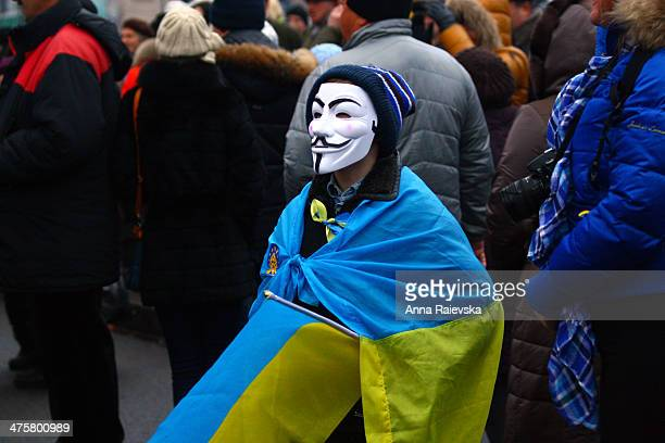 CONTENT] A child with a Ukrainian flag and a Guy Fawkes mask on the Independence Square in Kyiv