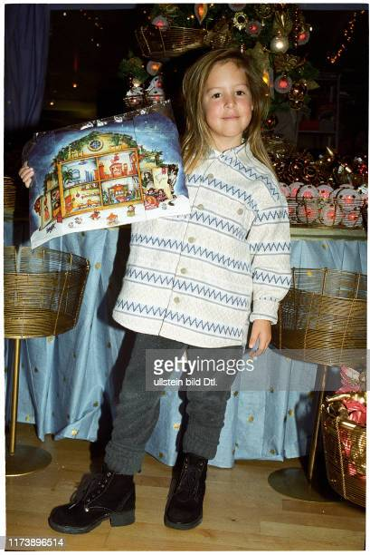 Child with Advent calendars, 1996
