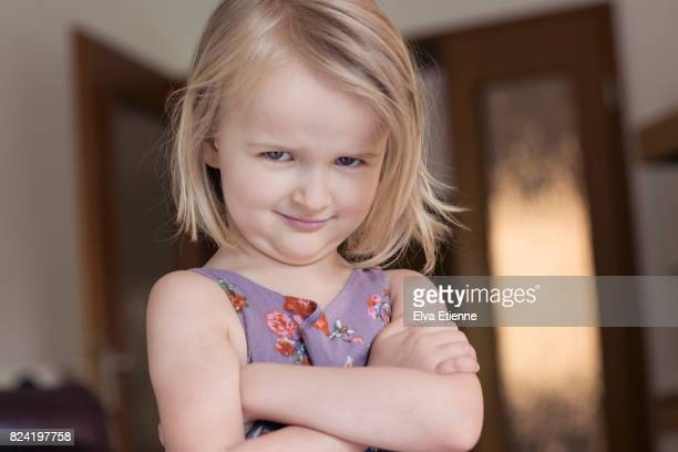 child (4-5) with arms folded and glaring, bossy facial expression - dictator stock pictures, royalty-free photos & images