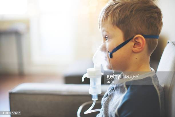 child with asthma inhaler at home - respiratory machine stock pictures, royalty-free photos & images