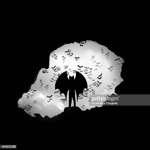 child with bat wings in a cavern - batman e robin foto e immagini stock