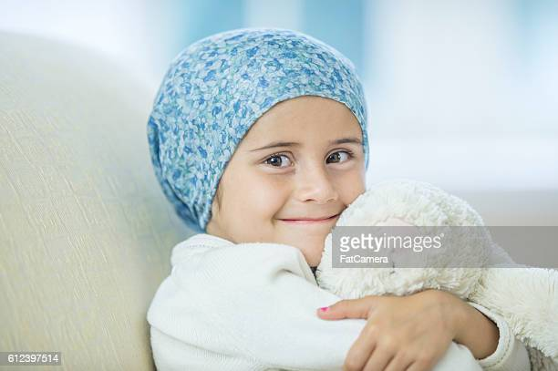 Child with Cancer Hugging Her Stuffed Animal