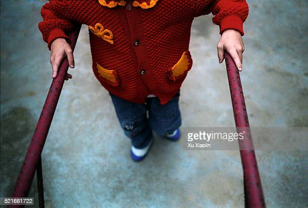 Child with Cerebral Palsy Practices Walking