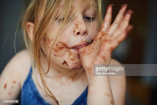 child with chocolate round her face - sally anscombe stock pictures, royalty-free photos & images