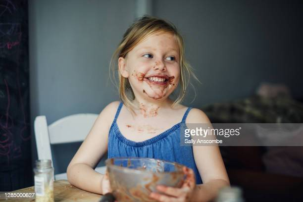 child with chocolate round her mouth - sally anscombe stock pictures, royalty-free photos & images