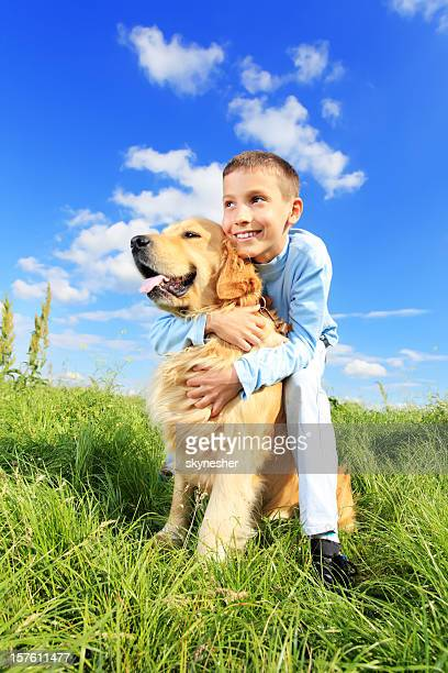 Child with dog outdoor.