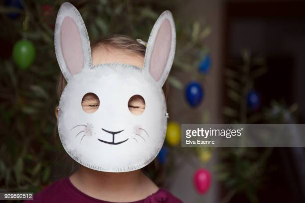 child with eyes closed tight and wearing a rabbit mask - rabbit mask stock pictures, royalty-free photos & images