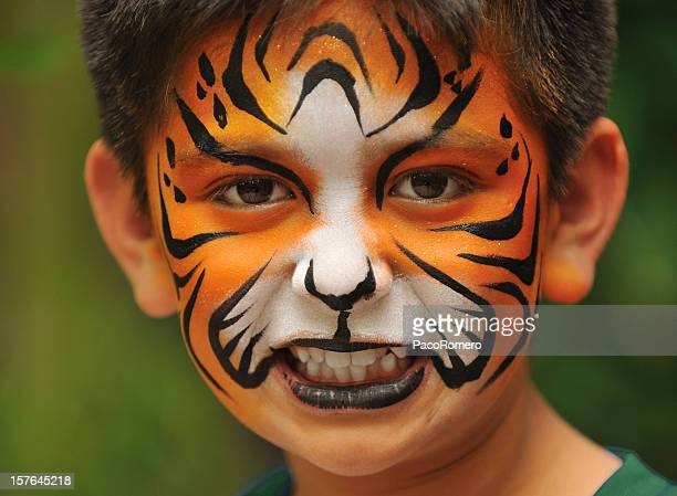 Child with face painted like a tiger