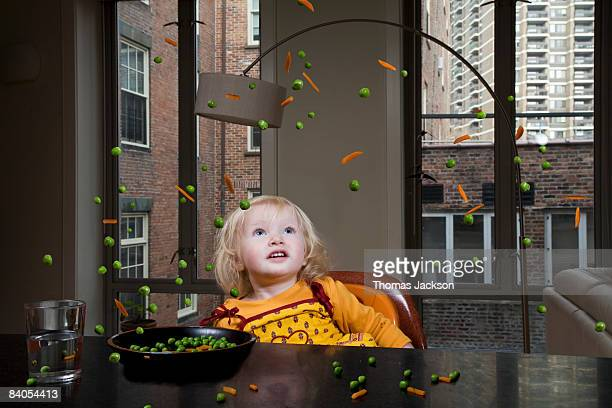 child with floating peas and carrots - paranormal stock pictures, royalty-free photos & images