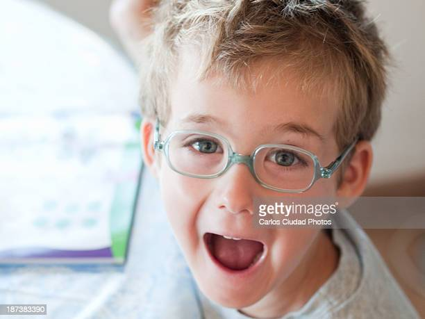 Child with glasses shouting