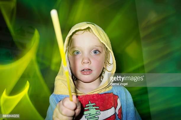 child with glow stick