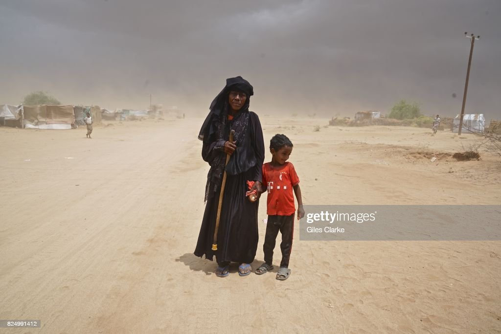 A child with grandmother in the remote IDP settlement of Abs located just 40km from the Saudi border.
