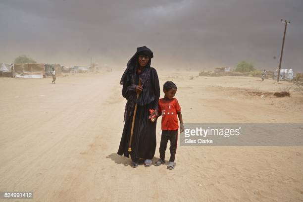 A child with grandmother in the remote IDP settlement of Abs located just 40km from the Saudi border
