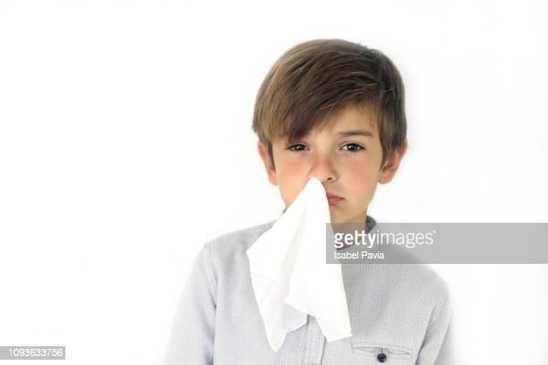 child with handkerchief in nose. cold, flu illness concept - nariz humano imagens e fotografias de stock