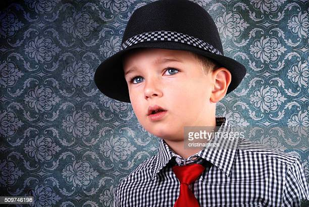 Child with hat and necktie