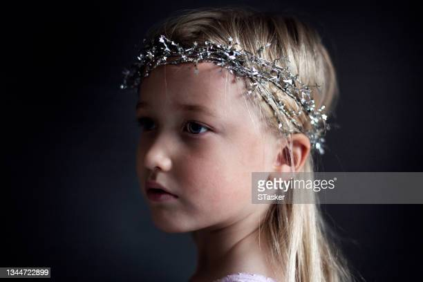 child with head decoration - st. albans stock pictures, royalty-free photos & images