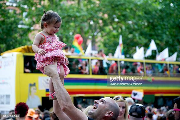 A child with her father take part in the Gay Pride Parade in Madrid on July 5 2014 in Madrid Spain State Protest LGBT Pride 2014 this year has the...