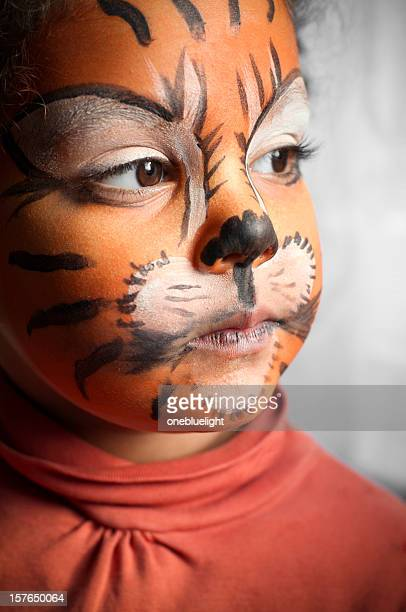Child with Her Tiger Face Paint, Daydreaming
