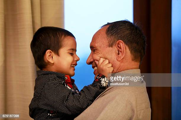 Child with his grandfather loving portrait