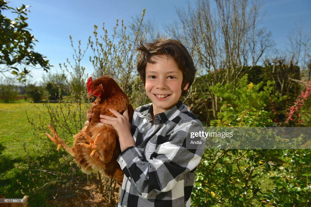 Child with his hen. Publication rights OK.