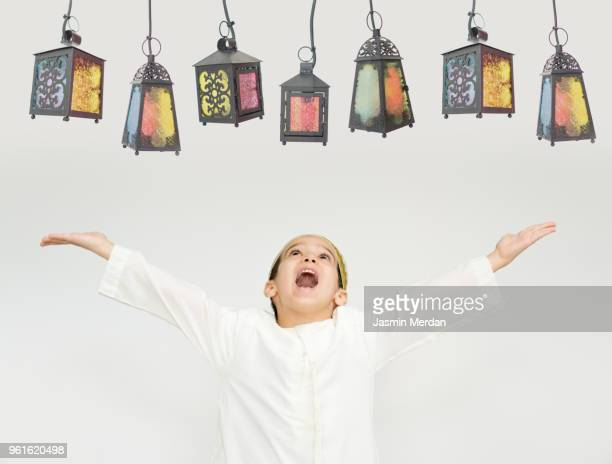 child with lanterns in ramadan - ramadan decoration stock pictures, royalty-free photos & images