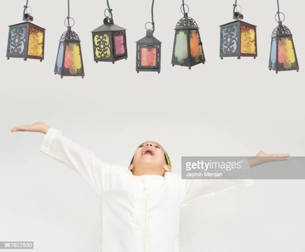 child with lanterns in ramadan - ramadan stock pictures, royalty-free photos & images