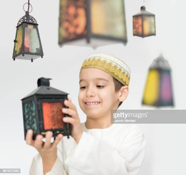 child with lanterns in ramadan - hari raya stock pictures, royalty-free photos & images