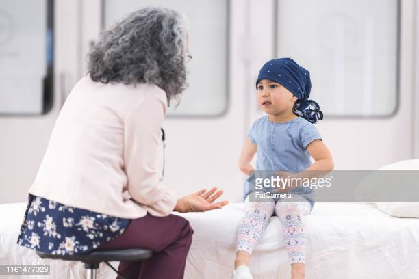 child with leukemia at the doctor's office - resilience stock photos and pictures